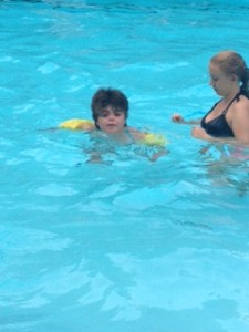 Leta learning to swim with water wings